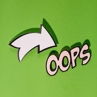 Dibujos animados estilo texto oops con signo direccional sobre fondo verde