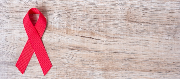 Diciembre mes del día mundial del sida, cinta roja