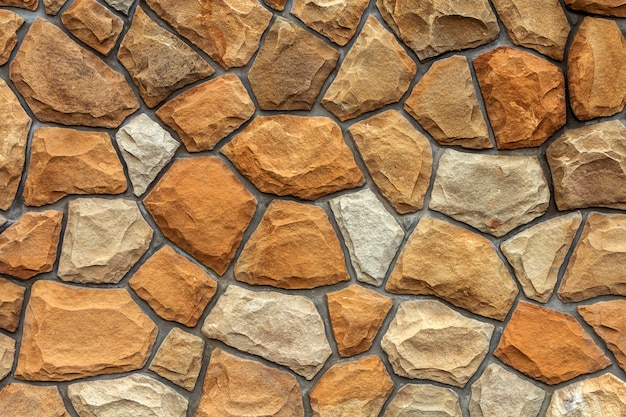 Diferentes tamaños de piedras de arena. fondo de muro de piedra