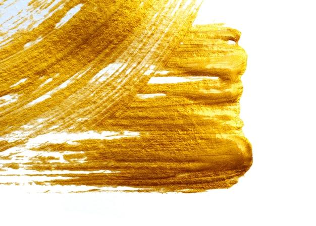 Diseño de elemento de pintura de trazo dorado sobre fondo blanco