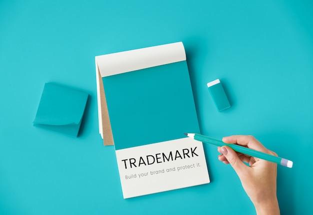 Diseño de la mano de la marca comercial de identidad de marca.