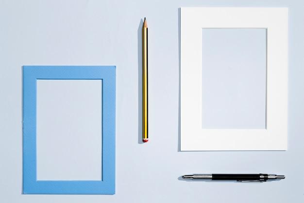Diseño moderno de artículos de papelería y marco.