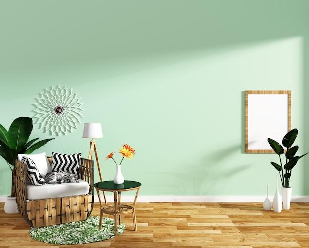 Diseño tropical, sillón, planta, gabinete sobre piso de madera y fondo de menta.