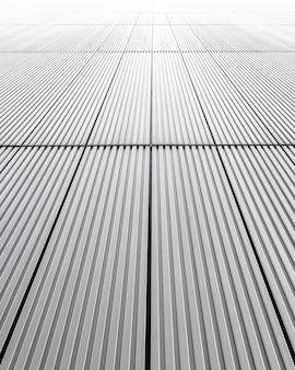 Disparo vertical de una fachada gris de un edificio, ideal para el fondo