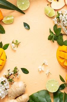 Disparo vertical de frutas cortadas en una distancia de color naranja claro