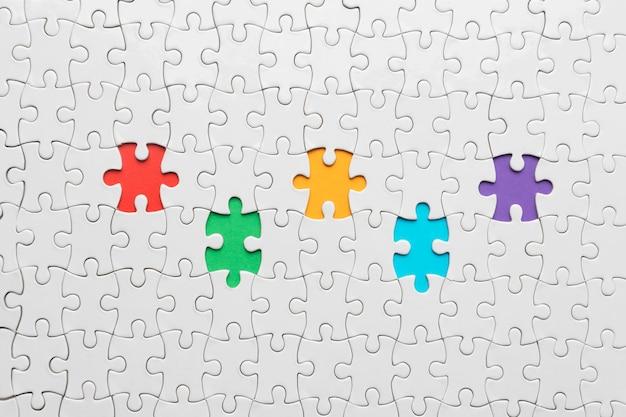 Disposición de diversidad laica plana con diferentes piezas de rompecabezas