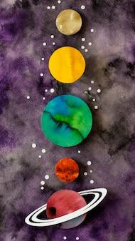 Disposición de estrellas y planetas de papel