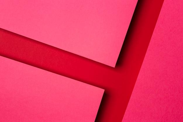 Disposición de la vista superior del fondo de hojas de papel rojo