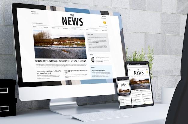 Dispositivos receptivos que muestran un sitio web de noticias receptivo en el escritorio
