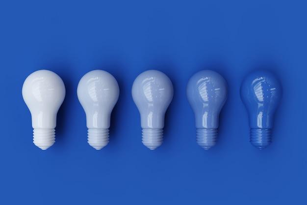 Diversas bombillas pantone de la sombra del color azul en fondo azul de fondo del color. concepto minimalista renderizado 3d