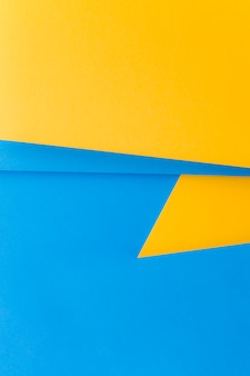 Doble fondo amarillo y azul para escribir el texto.