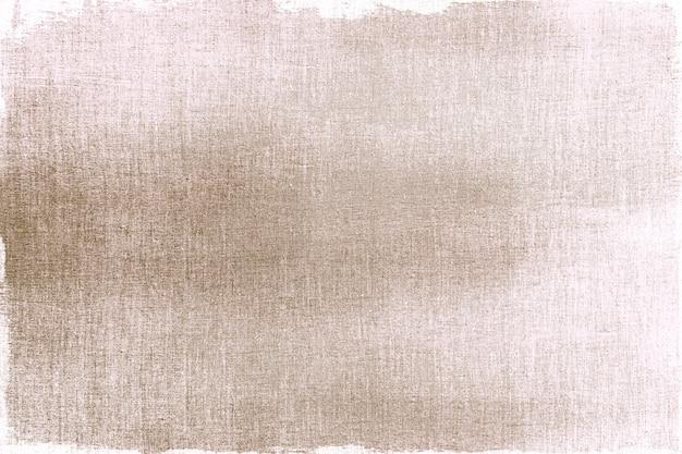 Dorado pintado sobre una tela texturizada