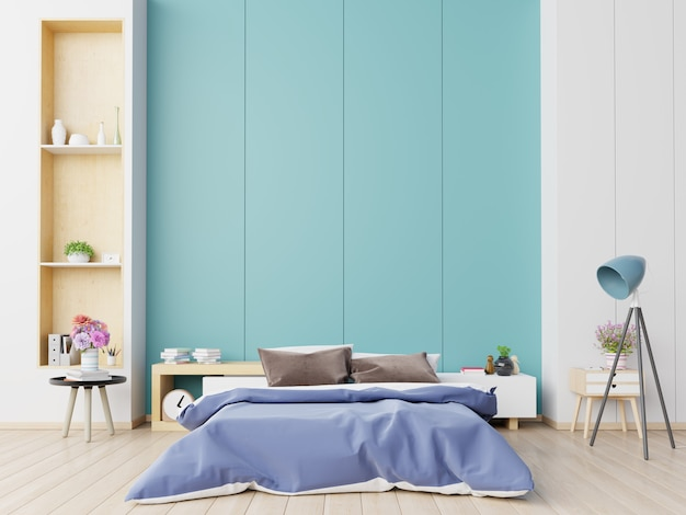 Dormitorio de casa de lujo con cama doble y estantes con pared azul sobre suelo de madera.