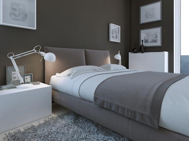 Dormitorio de lujo con paredes oscuras