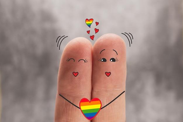 Dos dedos son como dos personajes de dibujos animados que se aman. amor del mismo sexo, lgbt, día del orgullo.