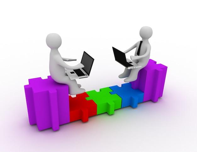 Dos personas con computadoras portátiles sentadas en piezas de un rompecabezas, están conectadas