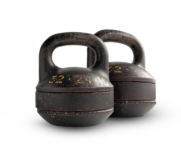 Dos pesas de gimnasia plegables del hierro que pesan, aisladas en el fondo blanco.