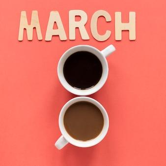 Dos tazas de café en forma de fecha para el día de la mujer.