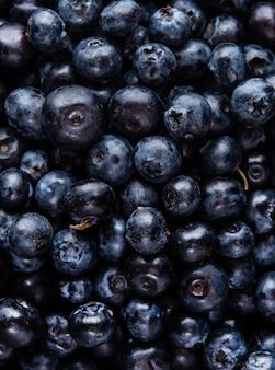 Dulce arándano fresco macro patrón vista superior copia espacio textura color azul