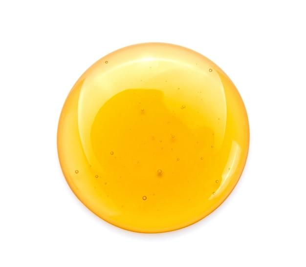 Dulce miel aislada sobre fondo blanco.