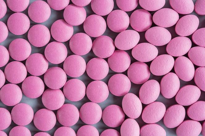 El tiro completo del marco de puede píldoras rosadas