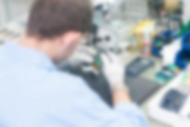 Electrónica de la planta de producción tema desenfoque de fondo