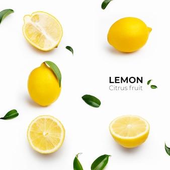 Elegante composición de juego de limones sobre una superficie blanca