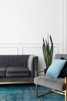 Elegante sala de estar de estética de lujo moderna de mediados de siglo con sofá de terciopelo gris y alfombra azul
