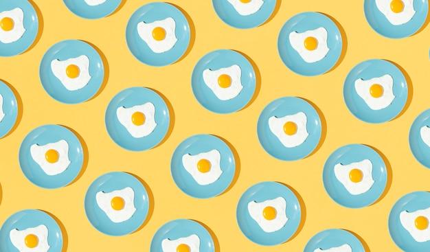 Elementos de patrón hechos con platos de huevo frito