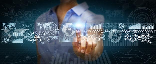 Empresaria usando pantalla táctil digital con gráficos