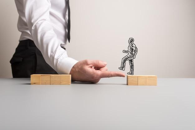 Empresario haciendo un puente de su dedo para un empresario silueta
