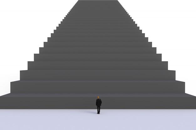 Empresario en miniatura de pie delante de las escaleras negras