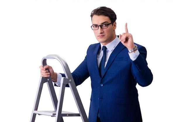Empresario en la parte superior de la escalera aislada