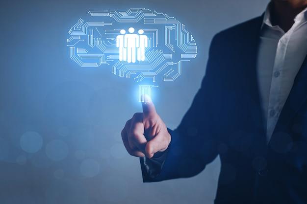 Empresario señalando el icono de recursos humanos. contratación de empleo headhunting concept