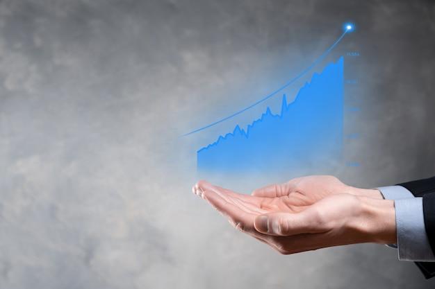 Empresario sosteniendo el crecimiento del gráfico y el aumento de los indicadores positivos del gráfico en su negocioinversión hasta el conceptoanalizar datos de ventas y economía estrategia y planificación mercadeo digital y acciones
