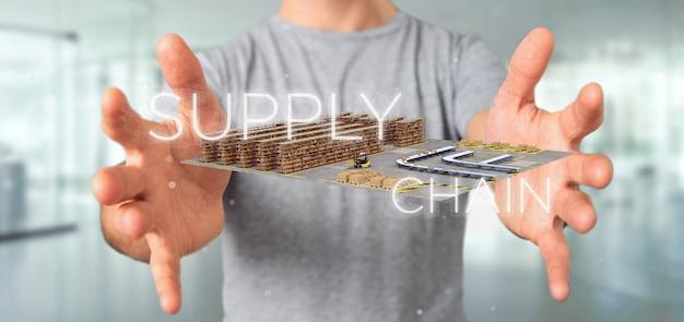 Empresario sosteniendo un título de cadena de suministro con un almacén