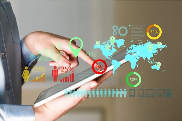 Empresario y tablet pc con iconos de negocios abstractos sobre fondo