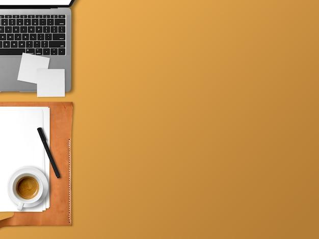 Endecha plana de la oficina moderna del espacio de trabajo de la computadora portátil de freelance con waffles de la taza de café