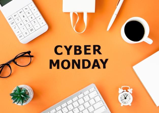 Endecha plana de teclado con café y bolsa de compras para el cyber monday