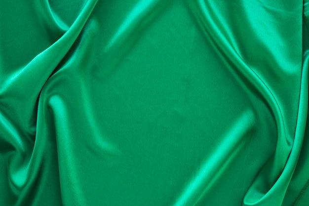 Endecha plana de tela verde para carnaval