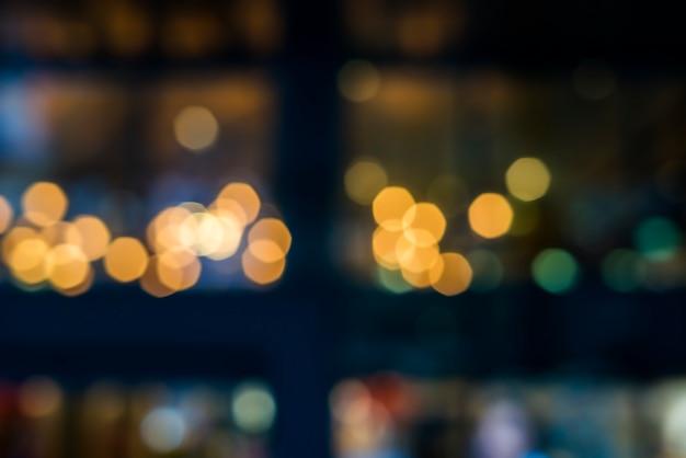 De enfocada luz bokeh, fondo abstracto en la noche photo