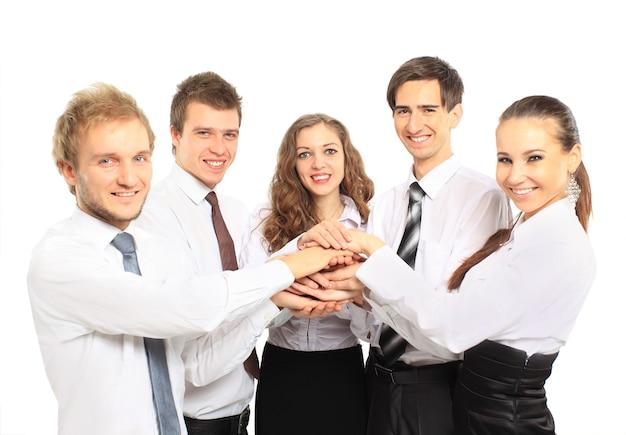 Equipo de negocios poniendo sus manos uno encima del otro Foto Premium