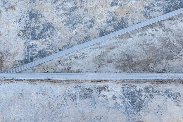 Escalera de cemento áspero grunge viejo en textura de fondo de diseño exterior de piso