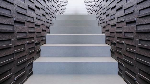 Escalera de piedra de diseño moderno al aire libre y ladrillo de pared en estilo loft.
