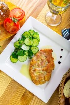 Escalope alemán con verduras