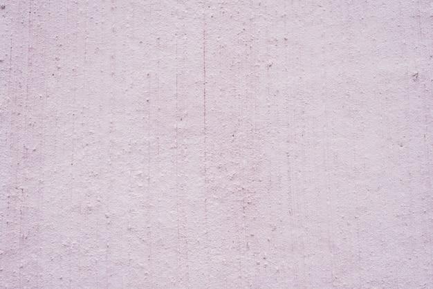 Escayola decorativa en la pared. textura de fondo lila. resumen de fondo morado.