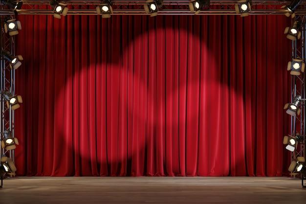 Escenario de teatro con cortinas de terciopelo rojo y focos