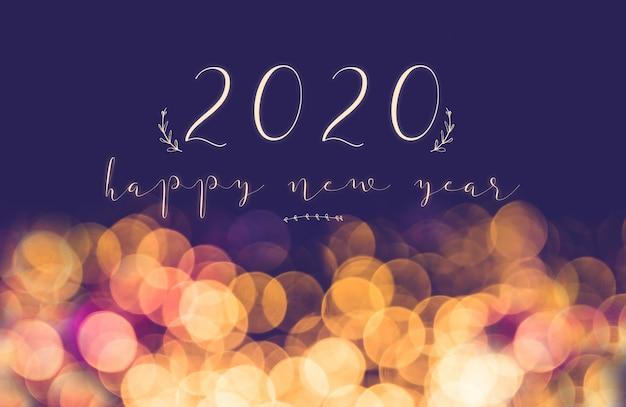 Escritura 2020 feliz año nuevo en vintage desenfoque festivo bokeh fondo claro