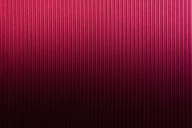 Espacio decorativo de color rojo anaranjado, degradado vertical de textura rayada. arte de papel tapiz. diseño.