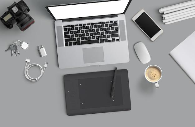 Espacio de trabajo mínimo: computadora portátil, cámara, café, cámara, bolígrafo, lápiz, cuaderno, material de escritorio de teléfono inteligente sobre fondo gris para espacio de copia vista superior plana